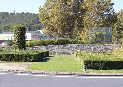 mur en pierre rond point Terrasson
